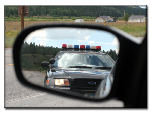 police car in rearview mirror
